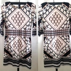 CK printed sheath dress with 3/4 bell sleeves.